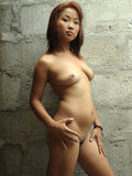 Horny Asian slut undresses and plays with her pussy