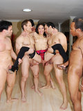 Asian slut Jayla Starr gets her mouth gang-banged by a roomful of cock