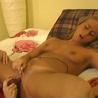 Young lesbians fuck on bed with various toys and tongues in these video clips