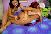 Hot teen lesbians get flirty on the bed from Flirty Pussy