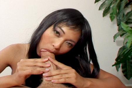 Wild Asian pornstar Mika Tan eating a cock and fucking hard