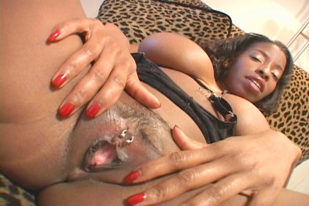 Busty black whore Vanessa Blue plays with a toy on her couch