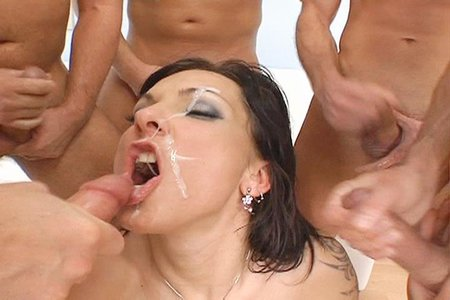 Brunette has her way with 5 big horny cocks