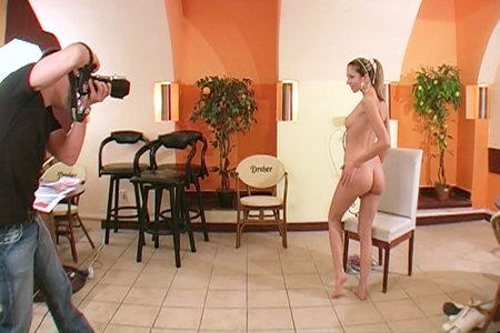 A killer babe named Brigitte strips until she's half naked for her porno interview
