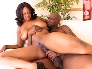 Ebony babe Baby Cakes rides big dick before receiving cum all over her tits