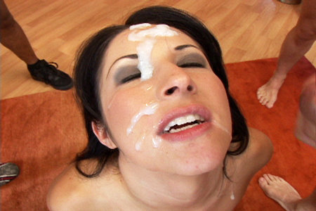 Young slut sucks fat cocks before getting her face splashed in thick cum from multiple ball bags