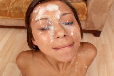 Mia Lina licks big cocks before getting multiple loads splattered on her face