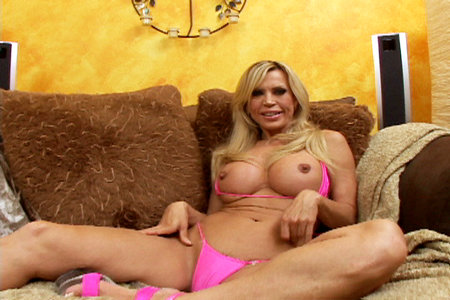 Amber Lynn strips showing massive tits before she gets her throat stuffed with sperm from Load My Mouth