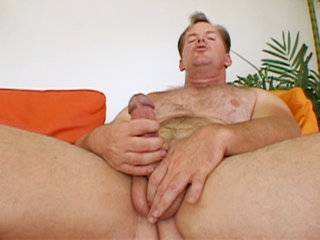 Gay Solo Masturbation : Frank Towers tugs at his cock in this solo session before blowing nut all over his own stomach!