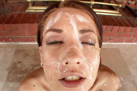 Coco Velvette bukkake facial after sucking on a large group of fully engorged men